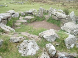 One of the bronze age huts. They must have been small people.