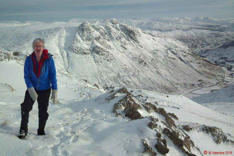 05 - Yours truly,  with Langdale Pikes, Great Langdale Valley, and beyond. (Taken near start of Bowfell Climber's Traverse).jpg