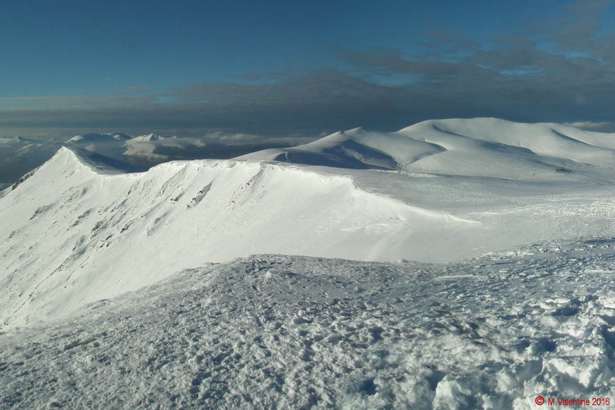 03-Cornices along Blencathra's famous saddleback, with Skiddaw massif rightwards behind. (taken from Blencathra summit)..jpg