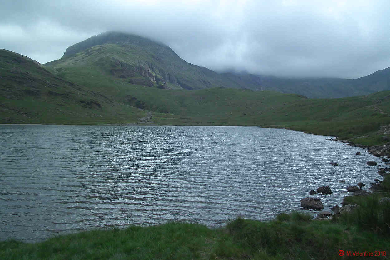 10 - Across Sty Heard Tarn to Great End, with mist over the Corridor Route..jpg
